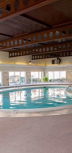 Relax by the pool at Camelot Place Apartments in Saginaw