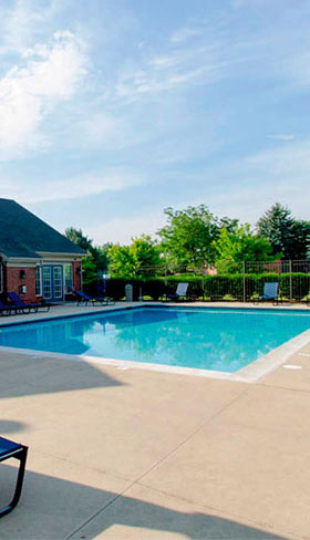 Relax by the pool at Chelsea Park Apartments in Taylor