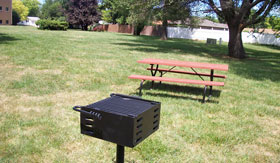 BBQ and picnic table at Apartments in South Sioux City