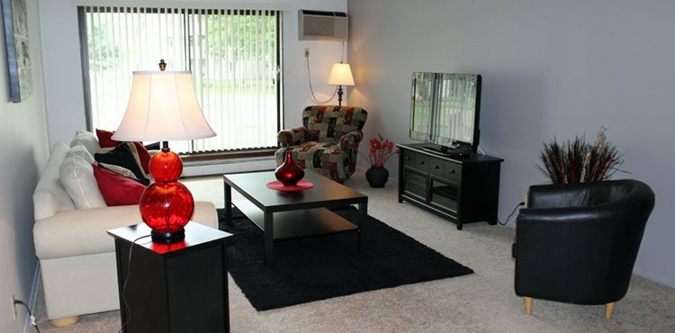 Model living room at Stone Grove Apartments in Burnsville, Minnesota