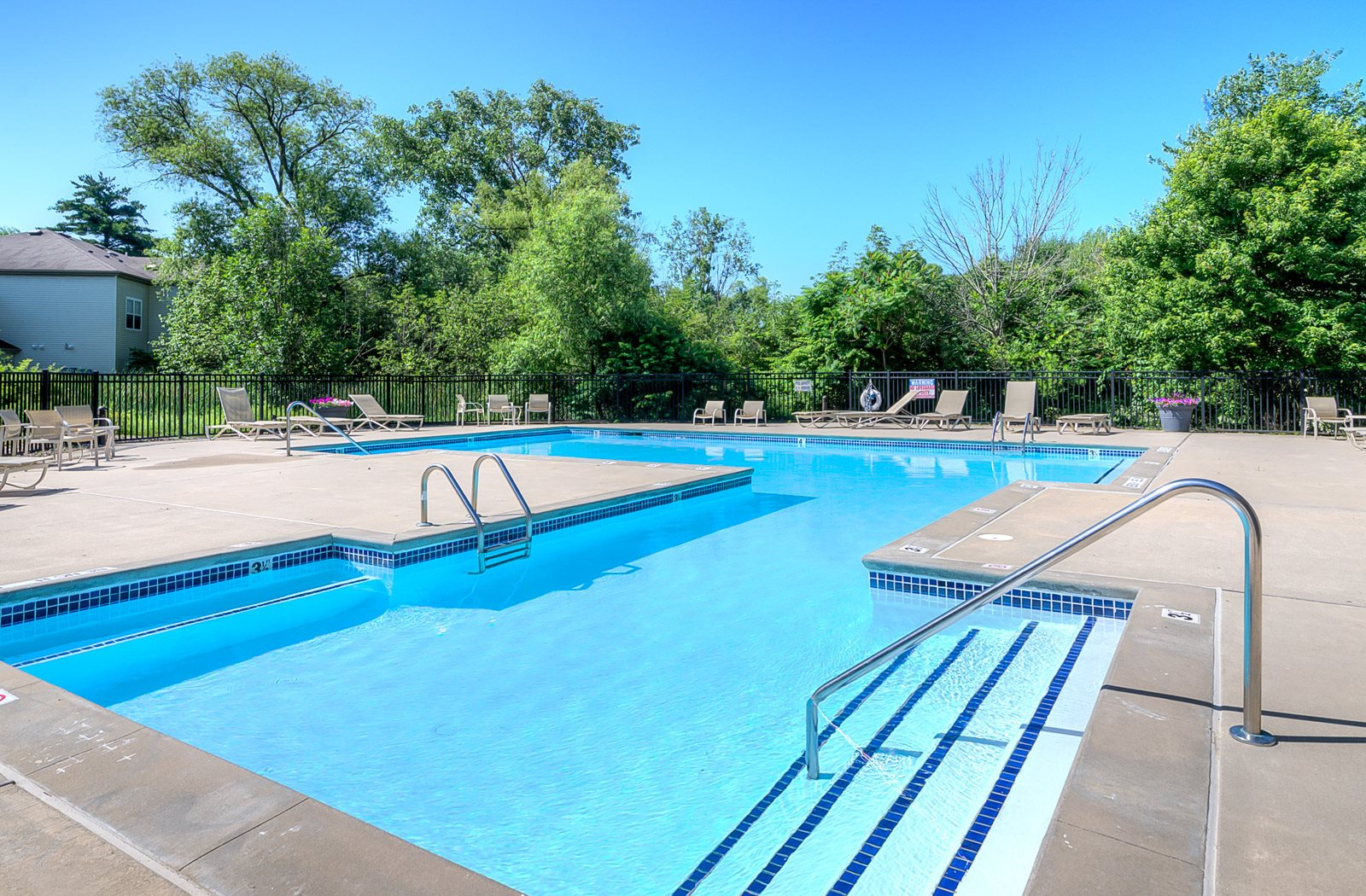 Outdoor Pool at Shoreline Landing Apartments in Norton Shores, MI
