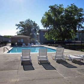 Relax by the pool at Concorde Club Apartments in Romulus