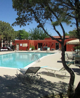 Relax by the pool at Wyoming Place Apartments in Albuquerque