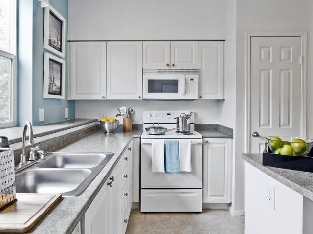 Model apartment home kitchen stove and microwave