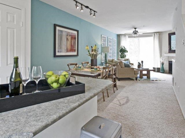 Model apartment home dining and living room with fireplace