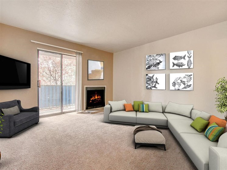 Living room with fireplace and patio Villa La Charles l Apartments in Albuquerque NM