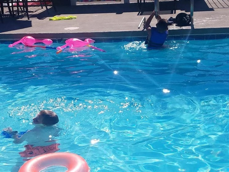 Family swimming in Pool Apartments for rent in Albuquerque NM l Villa La Charles