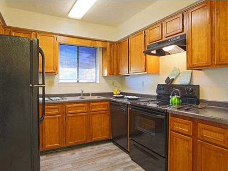 Full kitchen with window Apartments for rent in Albuquerque NM l Villa La Charles Apts