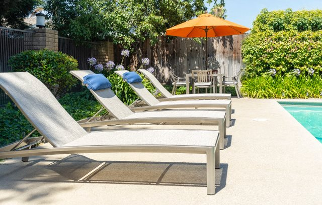 Relax by the Pool at Walnut Woods Apartments | Turlock Rentals