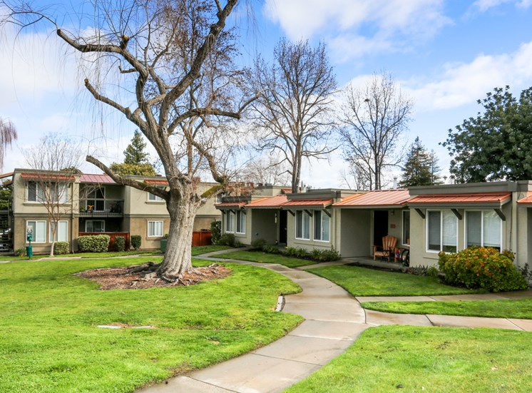 Landscaped Grounds with Buildings l Las Ventanas Apartments in Pleasanton CA