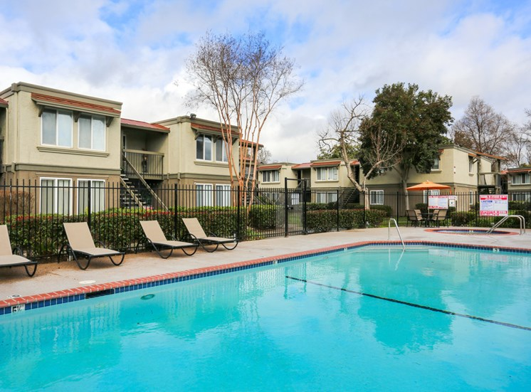 Pool and lounge chairs  l Las Ventanas Apartments in Pleasanton CA