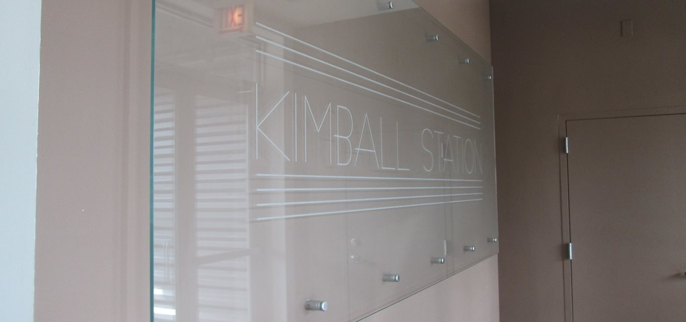 Sign at Kimball Station Apartments in Chicago, IL
