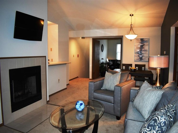 Fireplace Sitting Area With TV at Deer Run Apartments, Brown Deer, WI, 53223