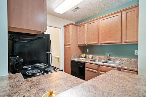 Model Floor Plan Kitchen and Pantry at Avenues at Steele Creek Apartments
