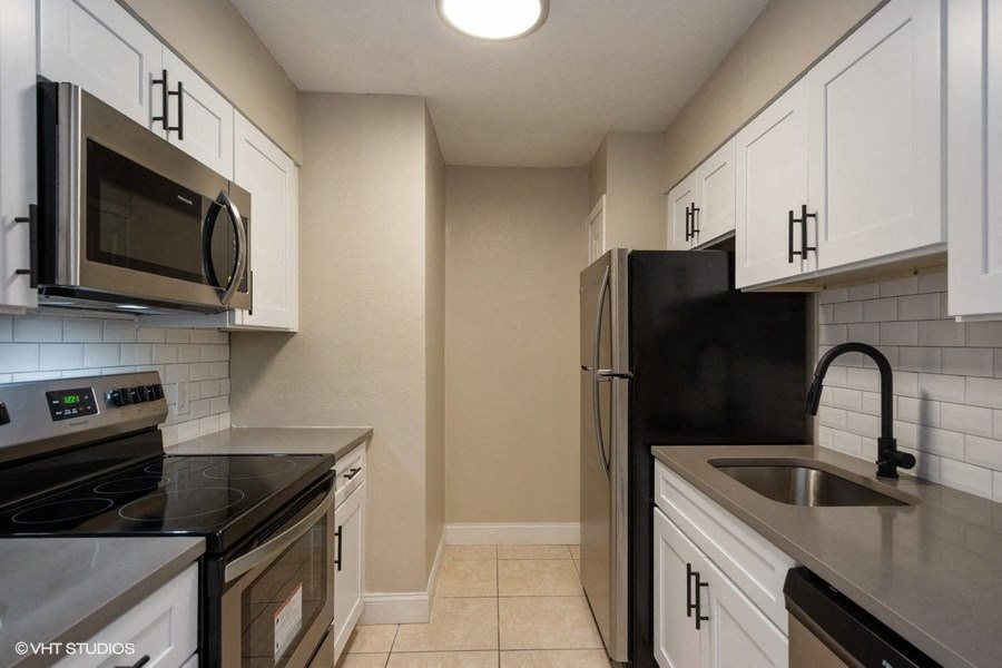 Newly renovated kitchens with subway tile backsplash and all new stainless steel appliances