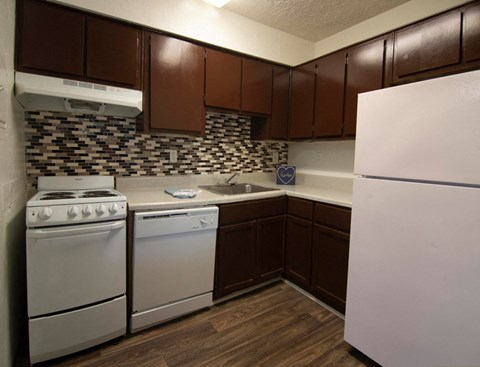 Wood cabinets with white appliances