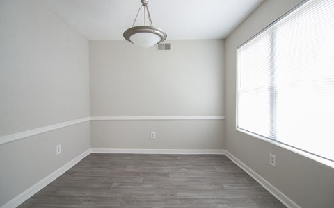Neutral color dining room with light fixture