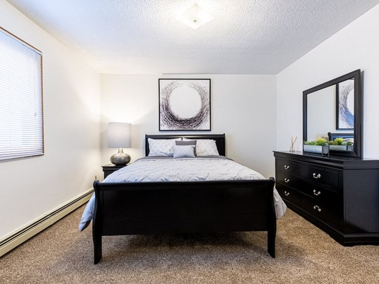 Master Bedroom in Uppertown Apartments in St Cloud MN