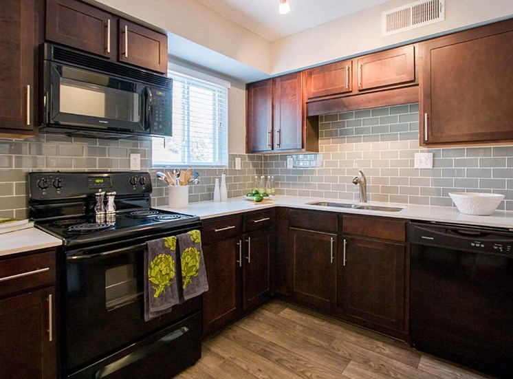 Gorgegous Kitchens Complete with Designer Finishes, Modern Appliances, Quartz Countertops and Tiled Backsplash at Artesian East Village, Atlanta, GA 30316