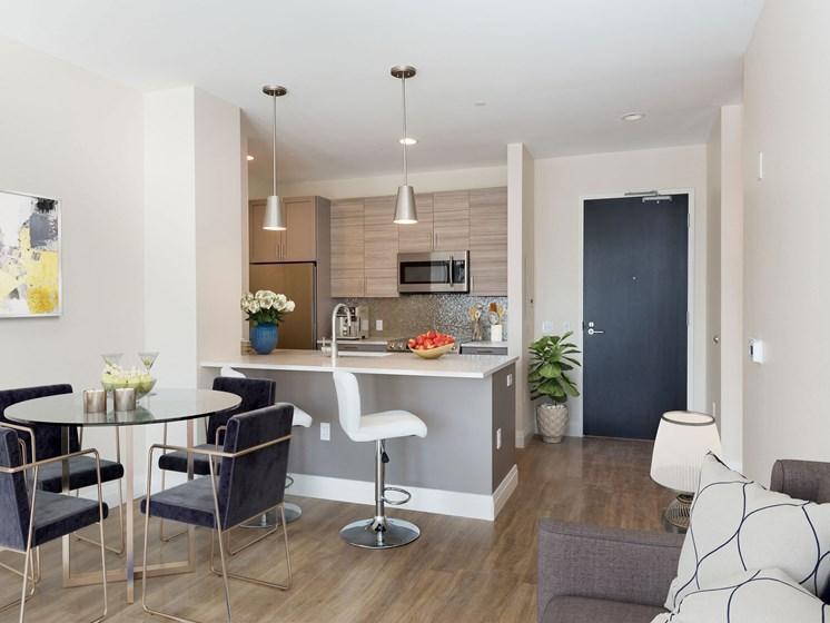 Gourmet-style kitchen featuring quartz countertops