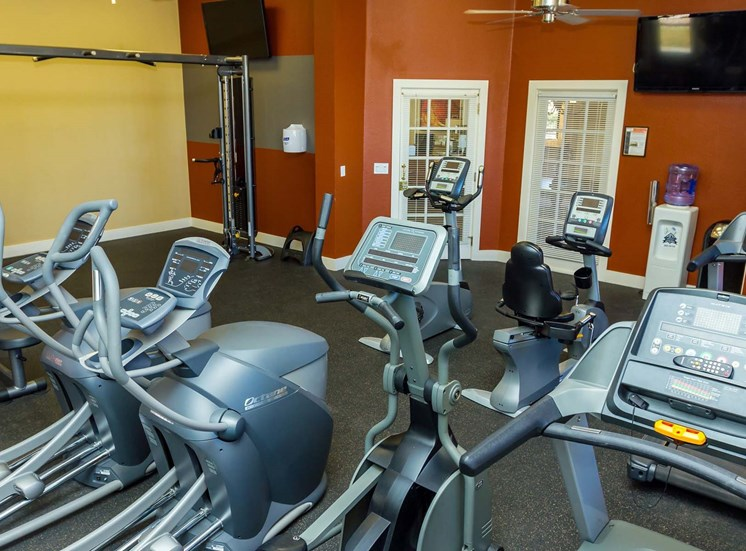 Remington at Lone Tree Fitness Center with orange walls and cardio equipment