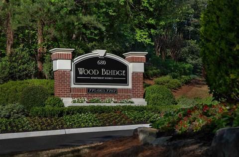 Monument sign for Wood Bridge Apartments in Alpharetta