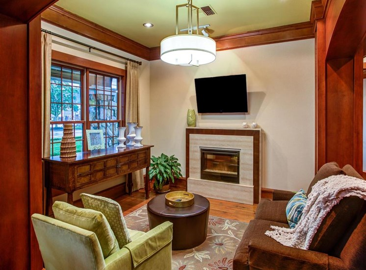 common sitting area with television and fireplace