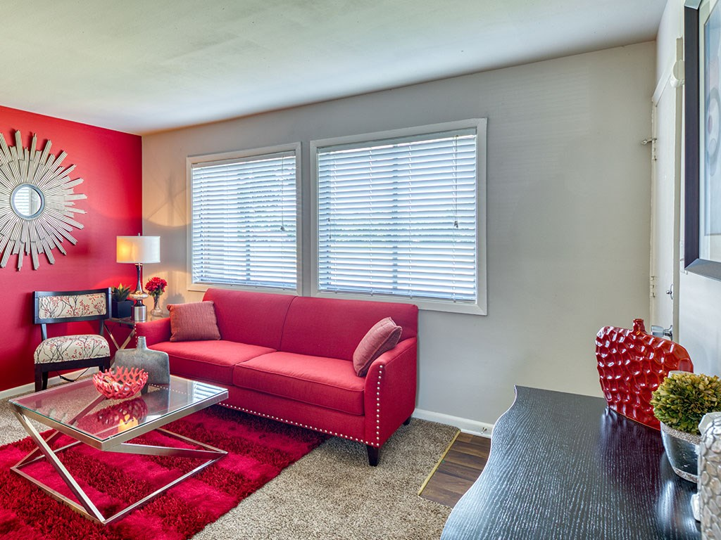 Red Sofa and wall at 11 North at White Oak Apartments