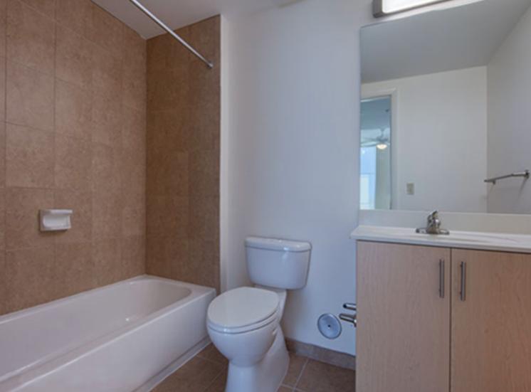 bathroom with tile tub surround