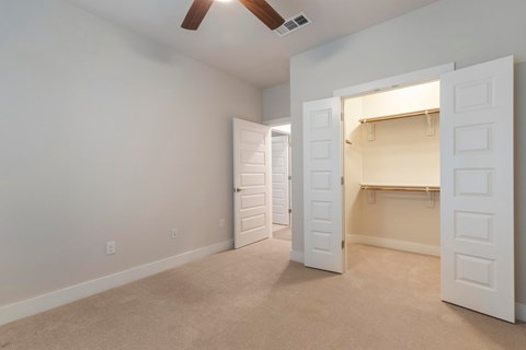 Bedroom with Spacious Closet and Built-In Shelves