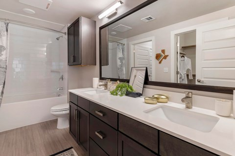 Bathroom with Double Vanity and Garden Style Tub