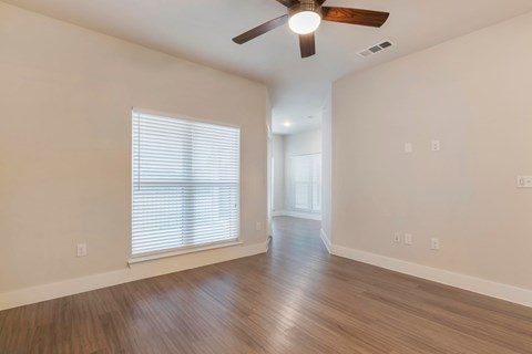 Living Room with Ceiling Fan and Hardwood Style Flooring