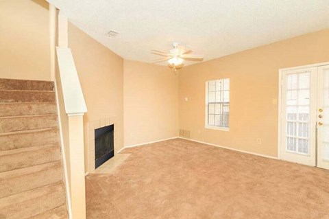 Two Story Apartment Home with Living Room Space and Indoor Fireplace