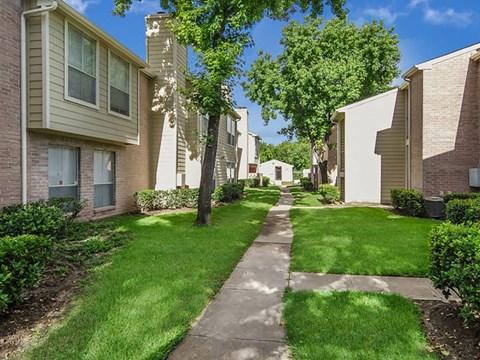 Walkways in between each building  | Northwest Houston Apartments For Rent | Savoy Manor