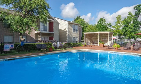 Lounge areas are available by the resident pool | Northwest Houston Apartments For Rent | Savoy Manor
