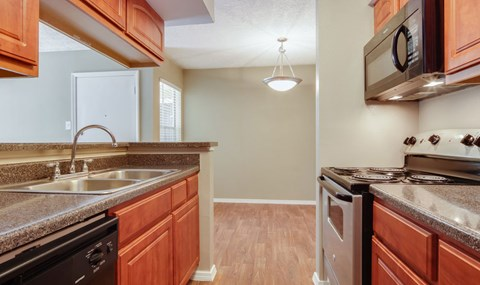 Renovated units include full black appliance package with cherry wood cabinets in select units | Southeast Apartments For Rent | Southpoint Apartments