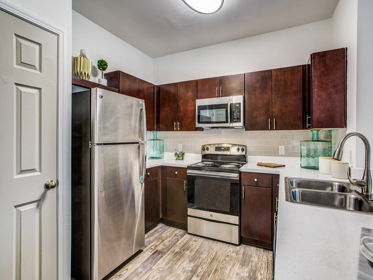 stainless steel appliances and wood floors in apartments