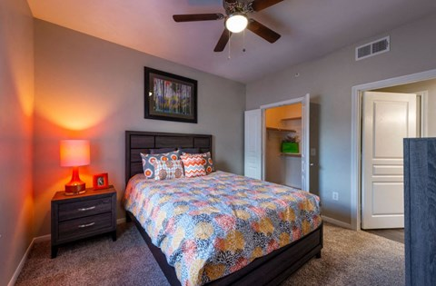 Master Bedroom with upgraded ceiling fan and full carpet | Houston Apartments For Rent | Cambria Cove
