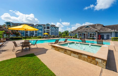 Gorgeous Resident Pool with Lounge Seating | Houston Apartments For Rent | Cambria Cove