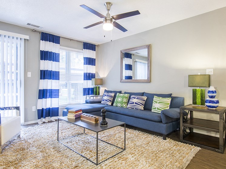 Living Room at The Addison at Sandy Springs Apartment Homes, Georgia, 30350