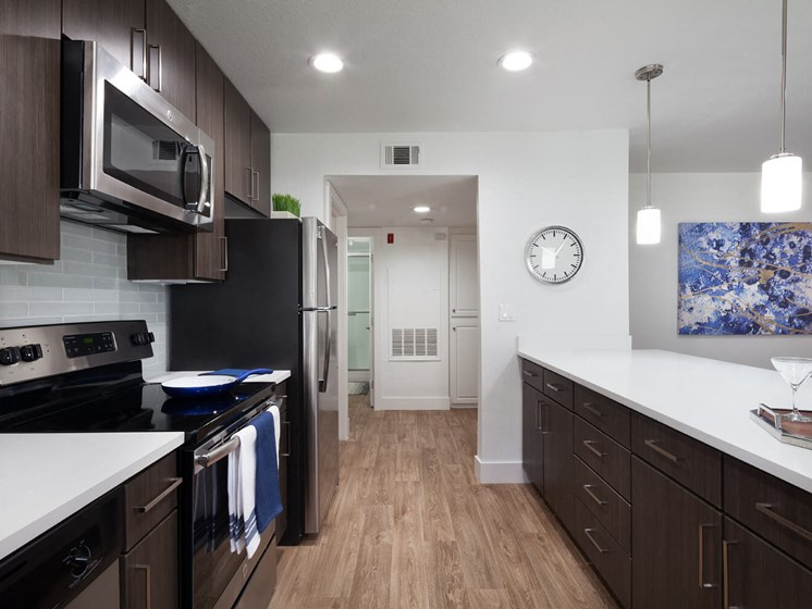 Enjoy Convenient Features Including A Built-In Microwave And Electric Cook-Top Range. at The Bryant at Yorba Linda, Yorba Linda, 92887