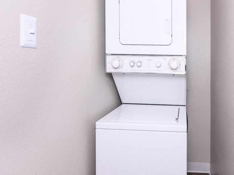 Stacked Washer/Dryer In Unit at Arcadia Apartment Homes, Colorado