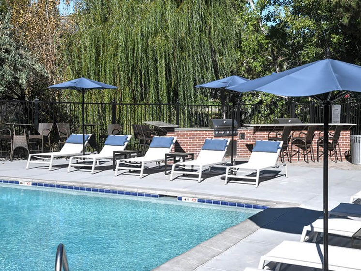 Lounging by the Pool at Arcadia Apartment Homes, Centennial