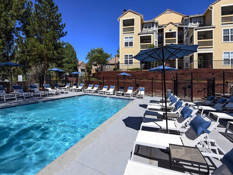 Umbrella Shaded Chairs by Pool at Arcadia Apartment Homes, Colorado, 80112