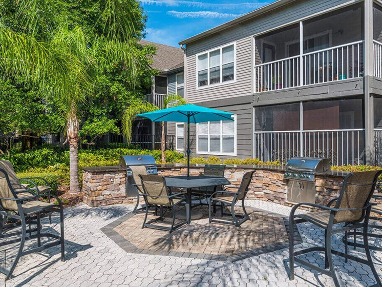 Barbecue And Grilling Station at Bay Club Apartments, Jacksonville