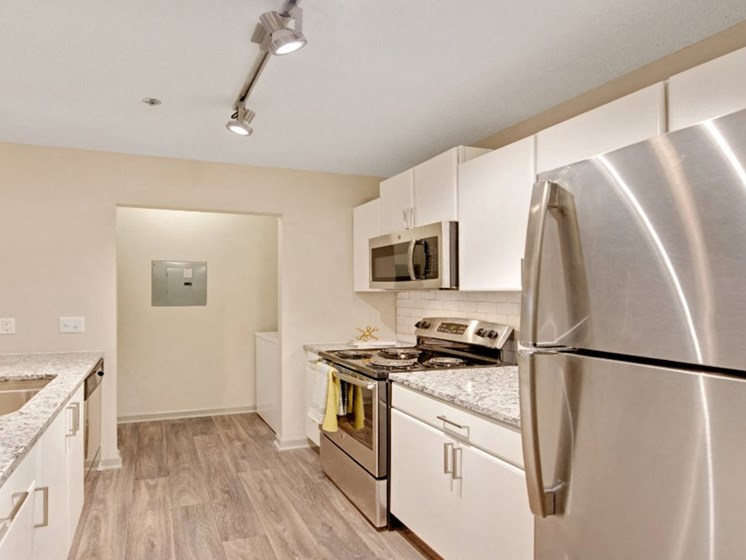Upgraded Kitchen With Wood-Style Flooring at Crosstown at Chapel Hill, Chapel Hill