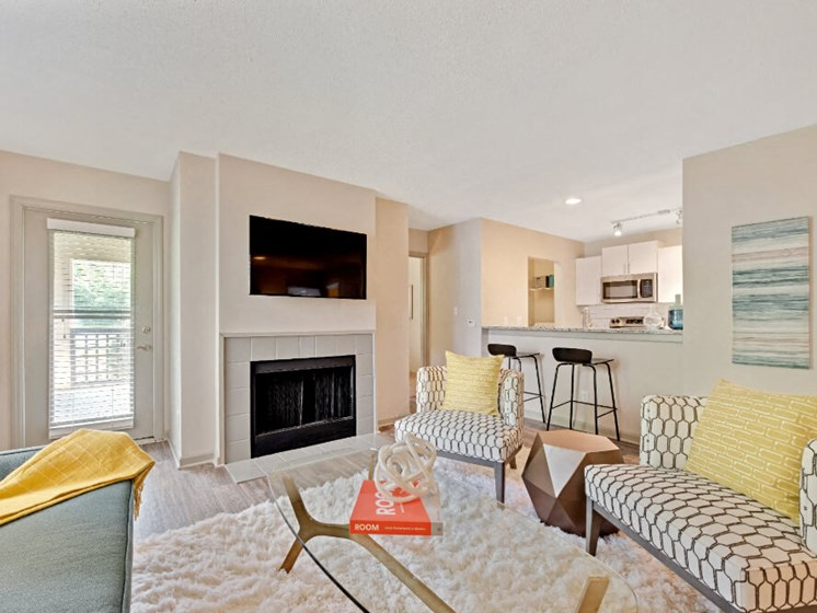 Living Room with Fireplace and Kitchen View at Crosstown at Chapel Hill, Chapel Hill, 27517