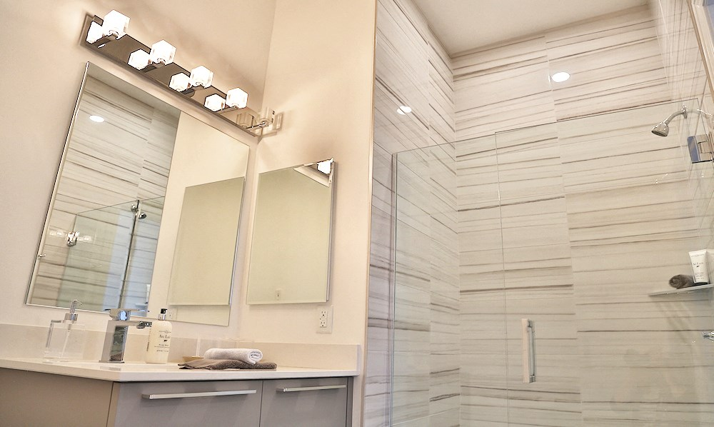 A bathroom with a shower in one of The James Ferndale senior apartments