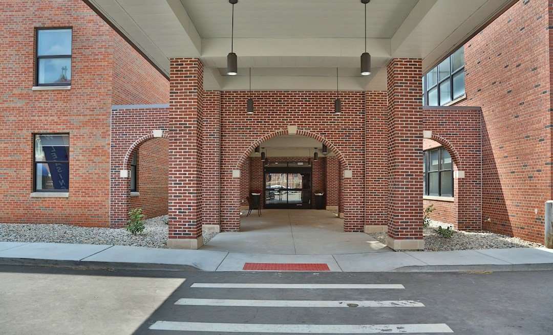 Beautiful entrance with wheelchair access at The James Ferndale luxury senior apartments