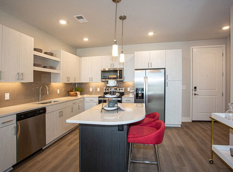 Fitted Kitchen With Island Dining at Revolve at OneFifteen, Overland Park, 66211